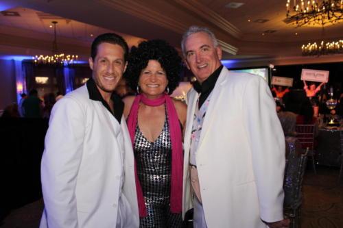 Brian Roland, Mary Robertson, Auctioneer Scott Robertson